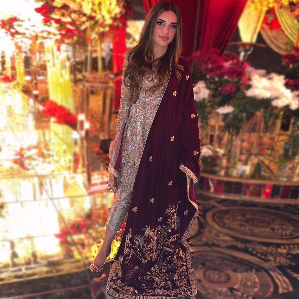 Picture of malaecahmalik donning a beautiful peplum, heavily handworked with intricate details and gleaming materials, paired with Zainab Salman's signature shawl making it a perfect pick for this years Winter Wedding Season