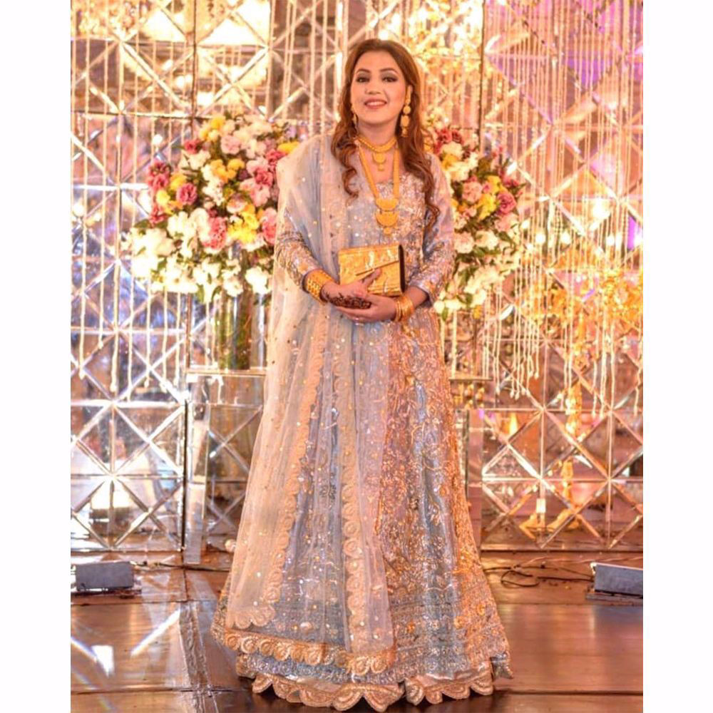 Picture of Our client Kiran Naveed puts togather ultimate elegence and grace by chosing this heavily embellished gown paired with a mukesh dupatta.