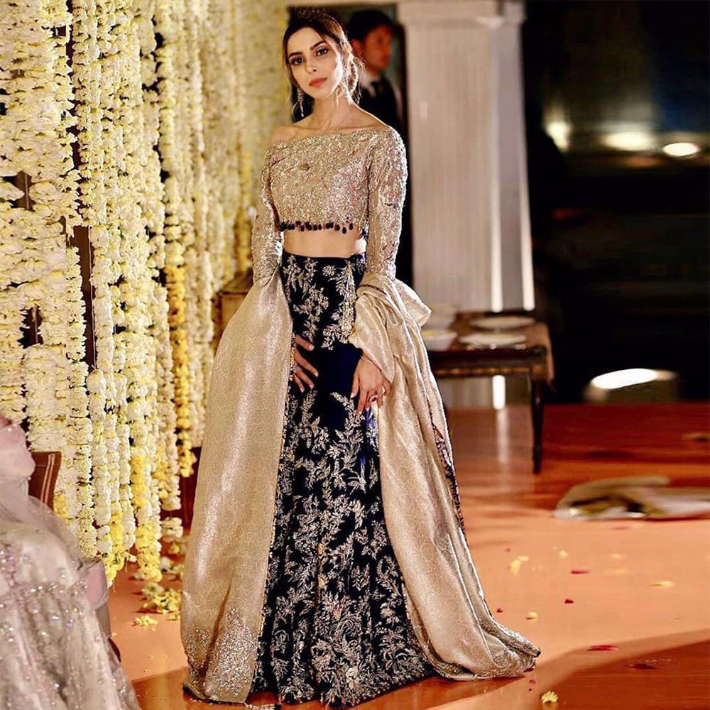 Picture of Our client making a statement wearing an exquisite lehnga choli from our collection.