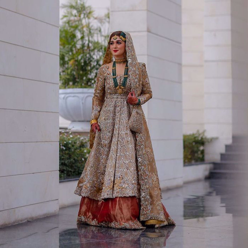 Picture of Curated with ravishing hues & meticulous details, Khadija dons one of our Timeless Classics, giving her the imperial look on her big day with a regal aura