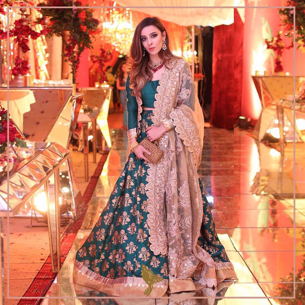 Picture of A hand-printed lehnga paired with a choli and a pristine zardozi dupatta.